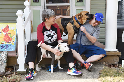 Al and Rita Lane sit out on the front porch of thier North Monroe Street homw with their dogs, Bean and Oscur . Harold Aughton/Butler Eagle Harold Aughton/Butler Eagle.