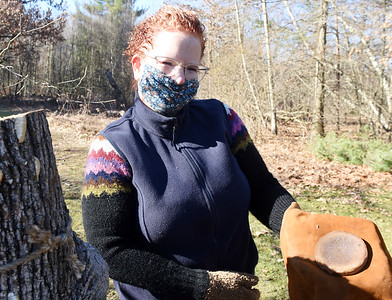 Volunteer Mary Core of Penn Twp. demonstrated how Native Americans made Maple sugar at the Succop Nature Park Saturday, March 13, 2021. Harold Aughton/Butler Eagle.