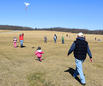 From left, Anna, 6, and her mother, Maggie Slater are joined by Evie, 3, and Josh Slater, flying a kite during His Kids Winterfest Saturday, March 14, 2021. Harold Aughton/Butler Eagle.