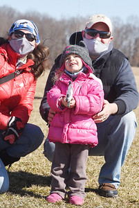 Maggie Slater and her husband Josh Slater help their daughter, Evie, 3, fly a kite during His Kids Winterfest at the Butler County Model Club in Clay Twp. Saturday, March 14, 2021. Harold Aughton/Butler Eagle.