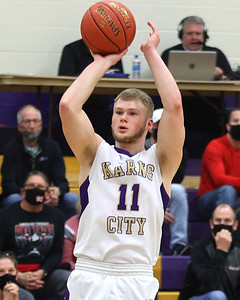 Karns City's Luke Cramer takes a shot form three point range in the Gremlins 72-46 home playoff win over Conemaugh Township Wednesday. Seb Foltz/Butler Eagle 03/17/21