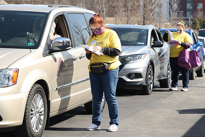 UPMC staff member Denise Bosilovich checks in a Covid vaccine recipient at the UPMC Lemieux Sports Complex Wednesday. UPMC hosted a drive-thru Moderna shot vaccination. Seb Foltz/Butler Eagle 03/17/21