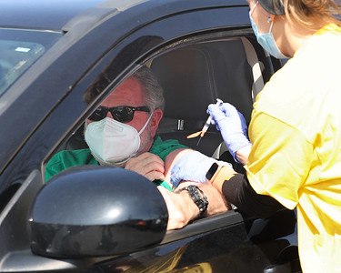 John Krepps of Harmony Township gets his first Moderna Covid-19 shot from UPMC nurse manager Liz Brunner at the UPMC Lemieux Sports Complex drive-thru vaccination event Wednesday. Seb Foltz/Butler Eagle 03/17/21
