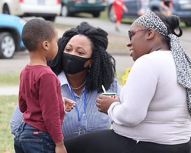 Elizabeth Smart (right) and her son Chase Fisher, 4, meet new Broad Street Elementary principal Vanessa Boyd  along with Fisher's sister Alexis Fisher,10, Tuesday at Rotary Park. The Butler school will reopen this fall. Seb Foltz/Butler Eagle 03/23/21
