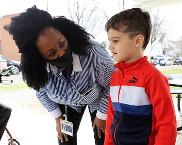 New Broad Street Elementary School principal Vanessa Boyd introduces herself to Urijah Metzgar,7, at Tuesday's district meet-and-greet at Rotary Park in Butler. Broad Street Elementary will reopen to area students this fall. Seb Foltz/Butler Eagle 03/23/21