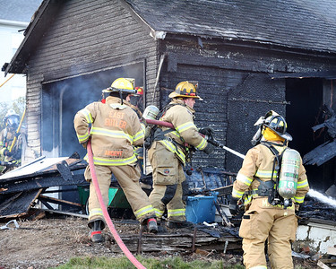 East Butler firefighters put out hot spots following a garage fire at a house on 907 Madison Ave. Seb Foltz Butler Eagle 03/24/21