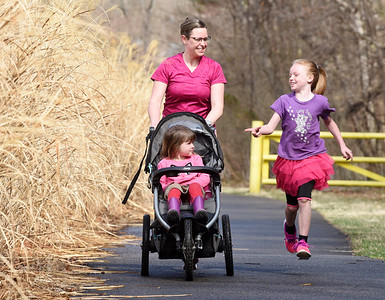 Jenna Taylor of St. Petersburg went for her morning run with her daughters, Kathryn, 4, and Kristine, 8, along the Foxburg - Parker bike trail Wednesday morning. March 24, 2021. Harold Aughton/Butler Eagle.