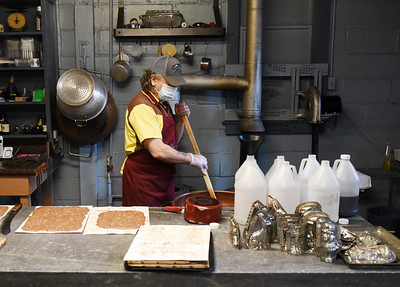 Barry Cummings, owner of Cummings Candy and Coffee, mixes a vat of chocolate syrup. According to Cummings, his family has been making candy at 146 N. Main St., Butler since 1905.  Harold Aughton/Butler Eagle
