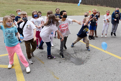 Second and third graders at the South Butler Primary School lined up to throw water balloons at principal Greg Mandalas in recognition of the district raising $1,000 for inclusion awareness Friday, March 26, 2021. Harold Aughton/Butler Eagle.