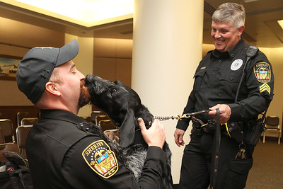 New Butler County Sheriff's Department police dog Bullet trys to give Deputy Eddie McGrady a kiss with K9 unit handler Sgt. Harry Callithen at Friday's meet-and-greet at the Butler County building. Seb Foltz/Butler