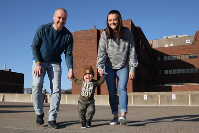 A year after their rooftop birthday tailgate, the family of Emmett McGarvey(center) got together at Butler Memorial Hospital to recount the event. Due to COVID precautions the family had a sort of tailgate while Evan  and Megan McGarvey(pictured)  were in the hospital for Emmett's delivery. The family discovered his gender from a sign in the window. Left to right: Father Evan McGarvey, Emmett McGarvey, mother Megan McGarvey, grandparents Brian and Diane McGarvey.   Seb Foltz/Butler Eagle Left to right
