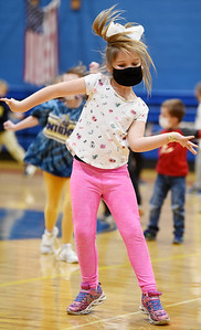 Third grader, Lucy Manzer of the South Butler Primary School, dances during an assembly celebrating the end of the 9-week quarter and recognizing students with awards and games as part of the School-Wide Positive Behavior Program Friday, March 26, 2021. Harold Aughton/Butler Eagle