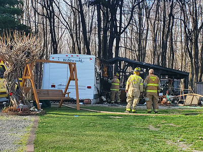 Multiple fire crews responded to a camper fire at Moraine Campgrounds Tuesday afternoon, but the camper was a complete loss to the fire. PHOTO BY EDDIE TRIZZINO.