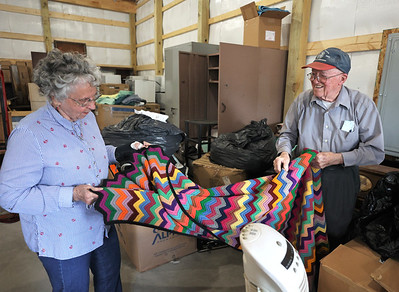 Butler County Veterans in Need founders Mary, 87, and Damian Hambley, 89, refold a blanket in the foundation's new storage warehouse on Route 8 north of Butler. The organization provides furniture for veterans in need. Seb Foltz/Butler Eagle