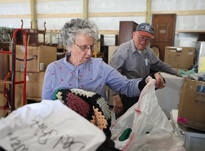 Butler County Veterans in Need founders Mary, 87, and Damian, 89, Hambley organize blankets in the foundation's new storage warehouse on Route 8 north of Butler. Seb Foltz/Butler Eagle
