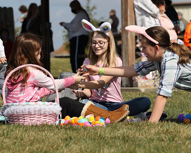 Isabelle Parisi,12,(center) Avery Hensch,9,(left) and Hailey Allison, 11, trade Easter candy following Winfield Township's Easter Egg Hunt Saturday. Over 100 kids and adults flocked to Winfield Township Community Park in Cabot for the event that featured food carts, a petting zoo and the egg hunt. Seb Foltz/Butler Eagle 03/27/21