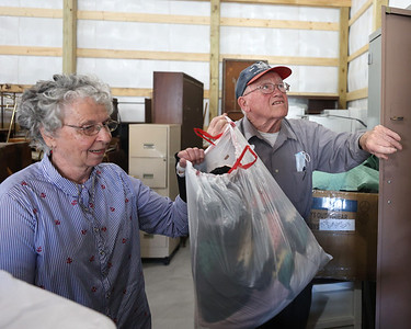 Butler County Veterans in Need founders Mary, 87, and Damian Hambley, 89, pull down a set of blankets in the foundation's new storage warehouse on Route 8 north of Butler. Seb Foltz/Butler Eagle