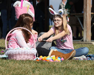 Isabelle Parisi,12, offers an Easter candy trade with Avery Hensch,9, at Winfield Township's Easter Egg Hunt Saturday. Over 100 kids and adults flocked to Winfield Township Community Park in Cabot for the event that featured food carts, a petting zoo and the egg hunt. Seb Foltz/Butler Eagle