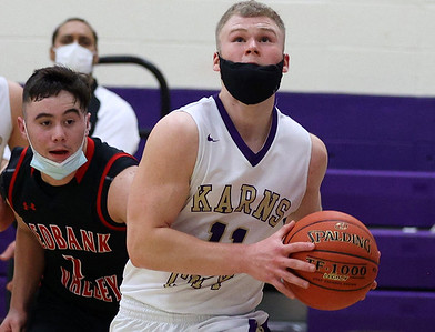 Karns City's Luke Cramer drives to the hoop against Redbank Valley's Bryson Bain in Tuesday's 73-45 home win. Seb Foltz/Butler Eagle 02/09/21