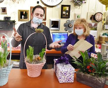 Butler Florist clerks, Steve Halley, and Dina Brownley prepare flower arrangements and gifts for Easter  Thursday, April 1, 2021. Harold Aughton/Butler Eagle.