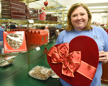 Lori Steinheiser, owner of Peter's Chocolates, claims that chocolate covered strawberries and rasberries are Valentine favorites this time of year. Harold Aughton/Butler Eagle.