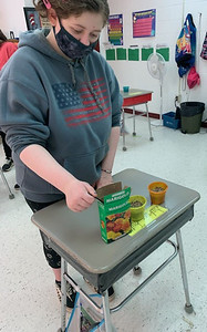 """""""Kylee Hilliard, a student in a life skills class in Slippery Area School District, planted marigolds for her mom, Savalla, during a class project.""""Submitted photo."""