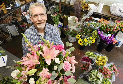 Ed Bloom of the Bortmas, The Butler Florist puts together a bouquet of flowers for a customer. Harold Aughton/Butler Eagle.