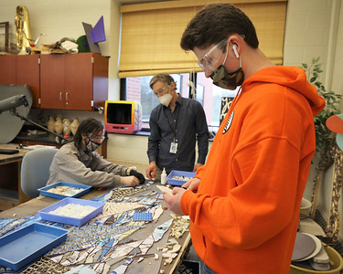 Seneca Valley tenth grader Charlie Madden works on a mosaic project that will be hung at the new district pool facility. Students in grades 9-12 are working on the project with contracted artist in residence teacher Elizabeth Klevens. Seb Foltz/Butler Eagle