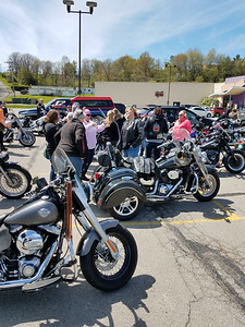 Members of Hot Metal Sisters mingled in the parking lot of Family Bowlaway Saturday after their ride to commemorate International Female Ride Day. ERIC FREEHLING/BUTLER EAGLE