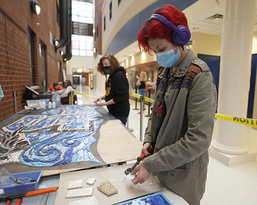 Seneca Valley art student Ruby Gomez works on a mosaic project that will be hung at the new district pool facility. Students in grades 9-12 are working on the project with contracted artist in residence teacher Elizabeth Klevens. Seb Foltz/Butler Eagle