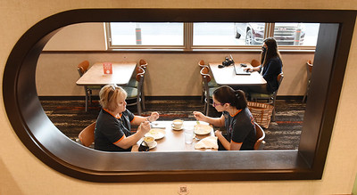 Eat'n Park employees Nancy Henderson, left, Loren Mayernik and Kayla Frattini were on hand to prepare for the opening of the new store along New Castle Road in Butler Tuesday. Harold Aughton/Butler Eagle.