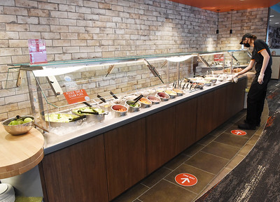 Taylor Blum of Butler prepares the salad bar for the opening of Eat'n Park's new restaurant along New Castle Road in Butler. Harold Aughton/Butler Eagle