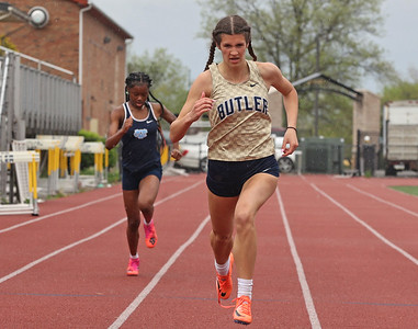 Butler's Ali Morrow pushes down the stretch to a second place finish in the 200 meter in Tuesday's WPIAL semifinal at Butler. Seb Foltz/Butler Eagle 05/04/21