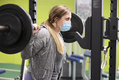 Butler YMCA manager Allison Clarke lifts in the facility's weight room Wednesday. Seb Foltz/Butler Eagle 03/10/21
