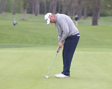 Rob McClellan finishes with a putt on 18 at Butler Country Club during Wednesday's U.S. Open WPGA local qualifier.  Seb Foltz/Butler Eagle 05/05/21