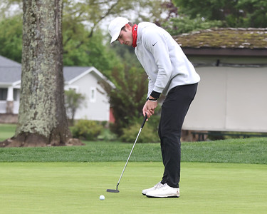 Benjamin Huber from Hampton watches his putt on 18 at Butler Country Club during Wednesday's U.S. Open WPGA local qualifier. Huber finished tied for second with par. Seb Foltz/Butler Eagle 05/05/21