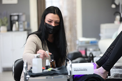 Lux Glam Bar Owner Nikki Wine gives a pedicure in her Cranberry area beuty shop. Seb Foltz/Butler Eagle 04/21/21