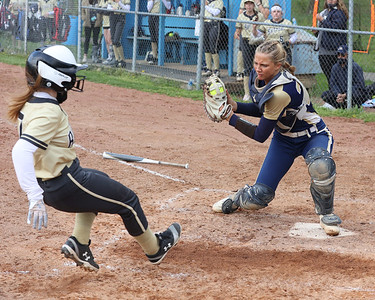 Knoch catcher Quinn Hughs tags out Butler's Hailey Winters at home in Knoch's 14-8 win at Laura J Doerr Memorial Park. Seb Foltz/Butler Eagle 05/06/21