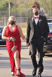 Emmy Kennedy and Hunter Hart walk up to Mars Area  Middle School for Prom walk. This year's senior prom was held on the football field at the Mars Athletic Complex Friday. Seb Foltz/Butler Eagle