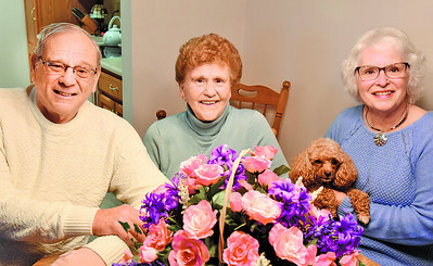 Rick Gallagher, 73 with his mother, Evelyn Gallagher, 90, and his wife, Becky Gallagher and the family dog, Riley, a miniature poodle. Harold Aughton/Butler Eagle