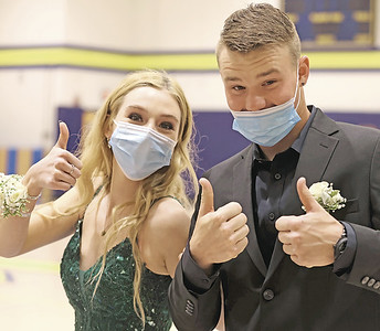 Kyler Kline (left) and Danny Ridgeway give a thumbs up at Mars Area School District's prom walk Friday. This year's senior prom was held on the football field at the Mars Athletic Complex Friday. Seb Foltz/Butler Eagle May 2021