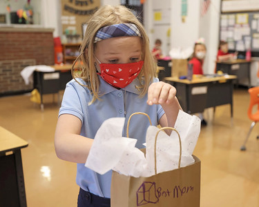 Butler Catholic second grader Hannah Weston, 7, the finishing touches on the gift bag for her Mother's Day project Friday. Seb Foltz/Butler Eagle 05/07/21