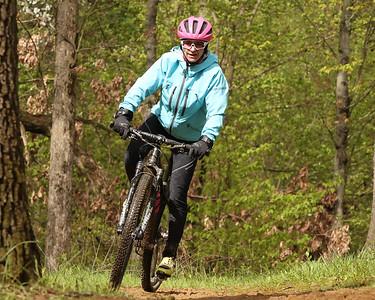 Julie Saeler of Butler leans into a turn at Alemeda Park Saturday. Saeler was a biking coach at Saturday's mountain bike clinic. Seb Foltz/Butler Eagle 05/08/21
