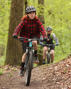 Olivia Reddy,13, cruises the trails at Alameda Park during Saturday's Mountain Bike Clinic hosted by Butler Parks and Recreation. Seb Foltz/Butler Eagle 05/08/21