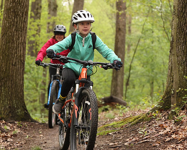 Leena Aprile, 9, of Cranberry cruises the trails at Alameda Park during Saturday's Mountain Bike Clinic hosted by Butler Parks and Recreation. Seb Foltz/Butler Eagle 05/08/21