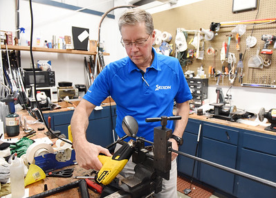 Ken Macadaeg, co-owner of All About Golf, prepares to replace a head on a golf club. Harold Aughton/Butler Eagle.