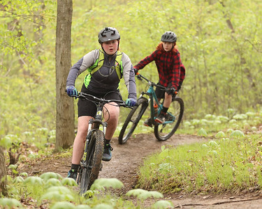 Sophie Brunger, 13, leans into a turn during Saturday's Mountain Bike Clinic at Alameda Park. The event was the first of it's kind hosted by Butler County Parks and Recreation. Seb Foltz/Butler Eagle 05/08/21