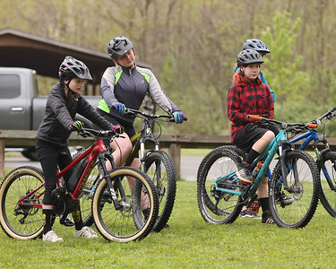 Girls listen to mountain bike instructor Michelle Thomas give pointers during Saturday's mountain bike clinic at Alemeda Park. The event was the first of its kind hosted by  Butler County Parks and Recreation. Seb Foltz/Butler Eagle 05/08/21