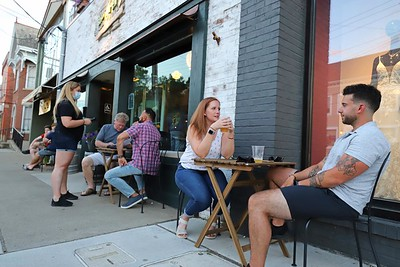 Steve Fortunato (right) and Lauren Hopkins sit for drinks outside of ShuBrew in Zelienople Saturday. Seb Foltz/Butler Eagle 06/20/20