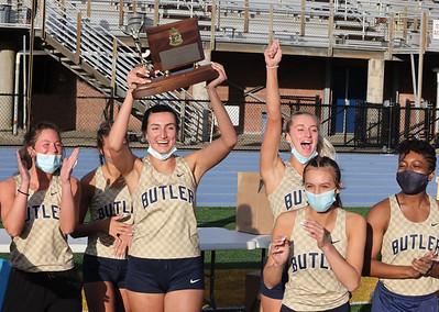 Butler's Ali Altman raises the WPIAL Girls Track Championship trophy with her senior teammates. Butler Boys and Girls both won team championships in West Mifflin Wednesday. Seb Foltz/Butler Eagle 05/12/21
